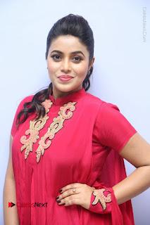 Actress Poorna Latest Stills in Red Dress at Rakshasi First Look Launch  0024.JPG