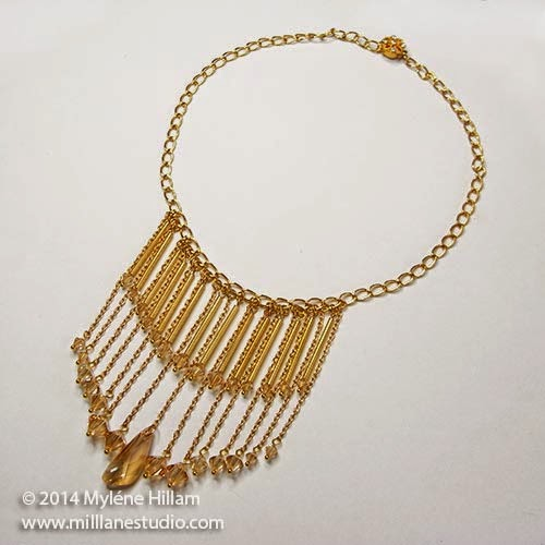 Bib necklace with dangling Golden Shadow crystals