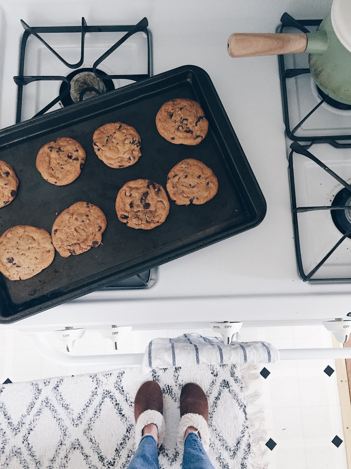 chocolate chip cookies on an all white stove