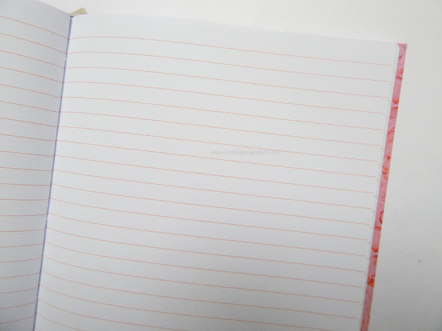 Interior shot of notebook showing dotted pink lines