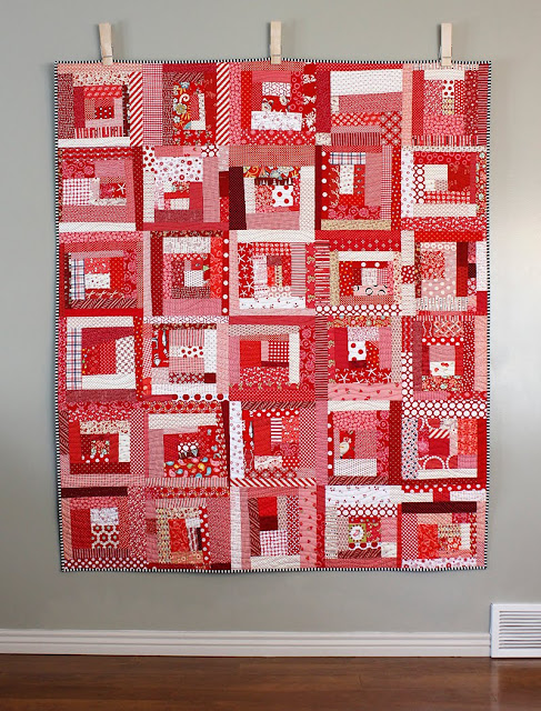 Wonky log cabin quilt in all red - there's a tutorial to make these blocks!