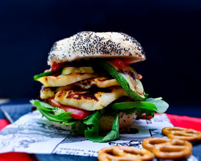 A stacked layered burger of halloumi, red pepper and courgette