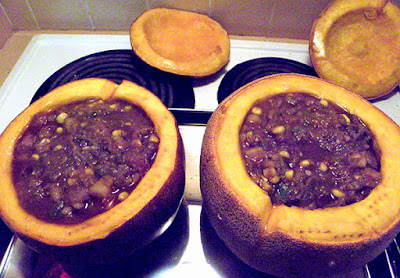 Two Pumpkins Filled with Fresh Stew