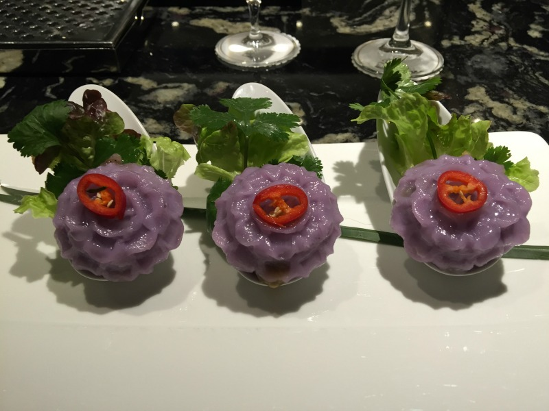 Chor Moang - purple dumplings filled with spicy pork and peanuts