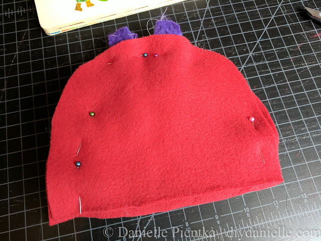 Sandwich the antenna between the  two piece for the hat. Pin.