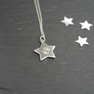 necklace-with-star-charm-with-handprint-on-it