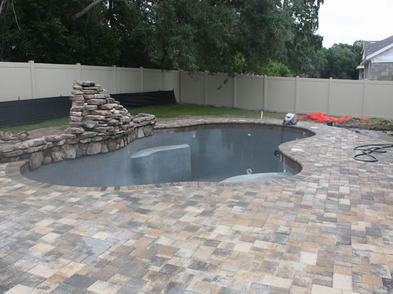 Tampa pool builder tropical pools and pavers how to - Installing pavers around swimming pool ...