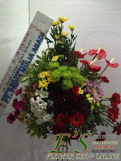 rangkaian bunga standing flower sselamat dan sukses