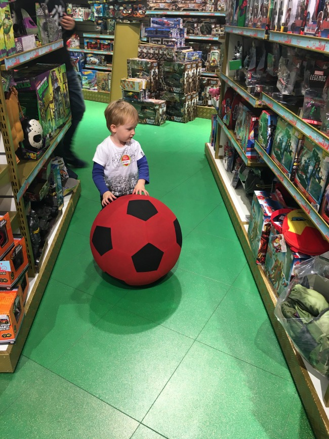 Playing-and-Party-Fun-toddler-with-ball-in-Hamleys-toy-shop