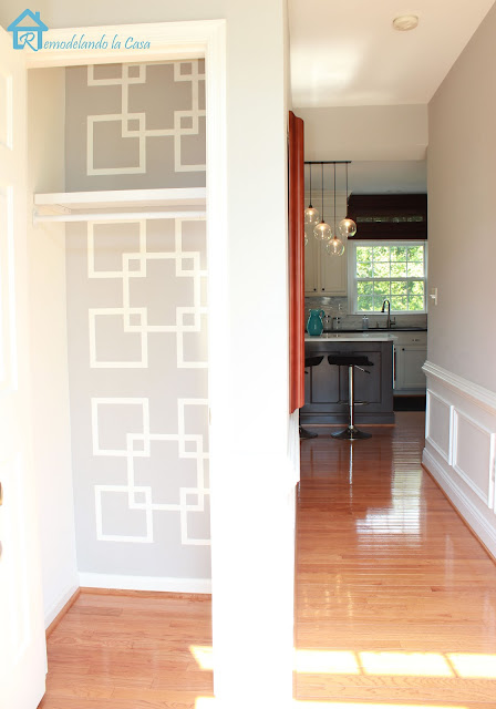 closet makeover with taped geometric design on wall