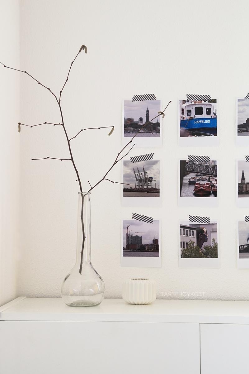 scandinavian minimalistic white january decoration with polaroid photos