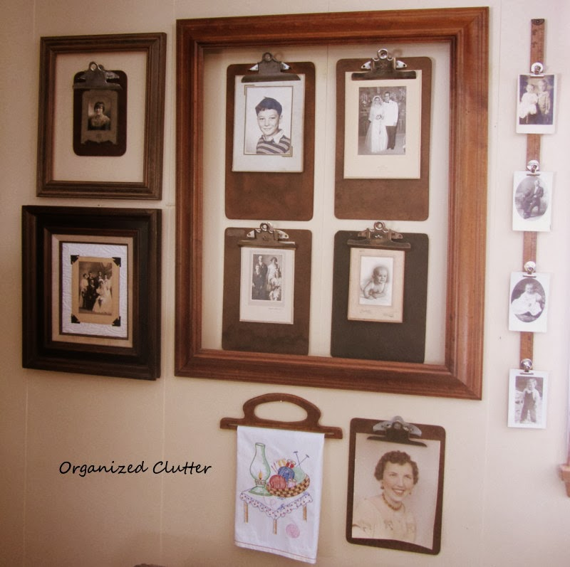 Clipboard Photo Wall www.organizedclutterqueen.blogspot.com