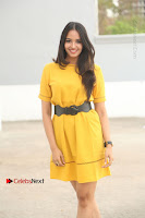 Actress Poojitha Stills in Yellow Short Dress at Darshakudu Movie Teaser Launch .COM 0009.JPG