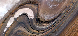 sinuous lines of stone,abstract landscapes of deserts of Africa ,Abstract Naturalism,abstract photography deserts of Africa from the air,abstract