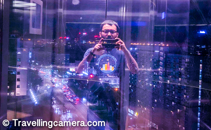 Above selfie is clicked in the lift of The Westin Hotel. That was my best place to click city-scapes. This was also an attempt to click the city but during the night my reflection also became part of the photograph. I loved this accidental selfie now.
