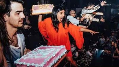 Priyanka Chopra and Nick throwing cake on audience