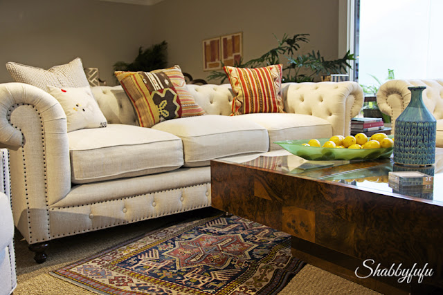 traditional nailhead sofa in a boho setting
