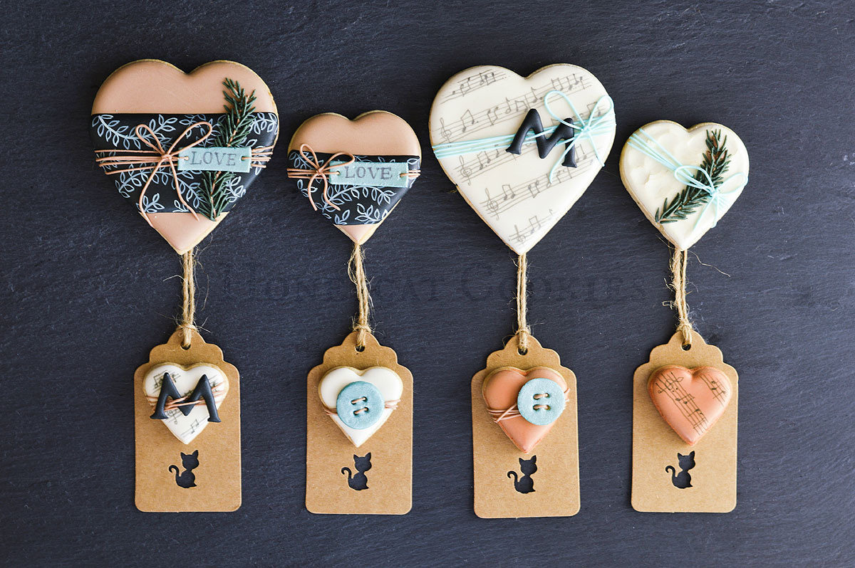Masculine Valentine's Day decorated cookies in wrapping and gift tag theme, photo by Honeycat Cookies