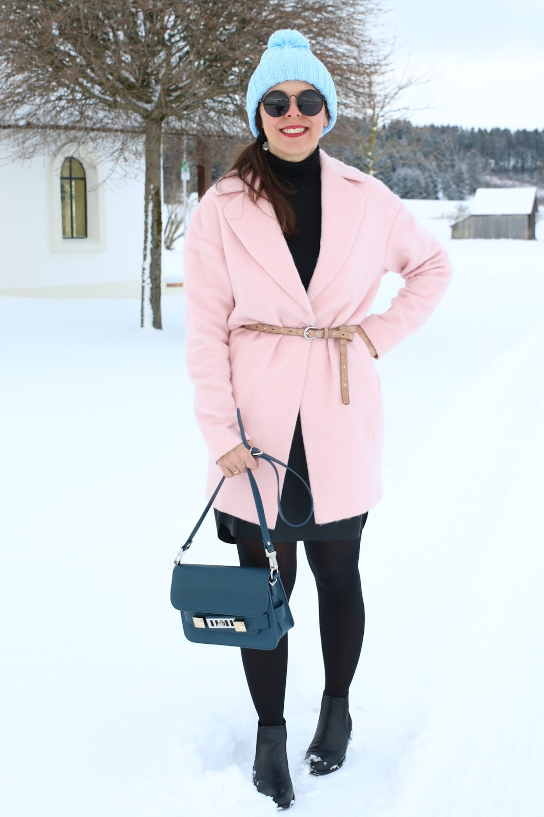 Outfit pink coat with belt, black leather skirt, black turtleneck, pale blue pompom hat