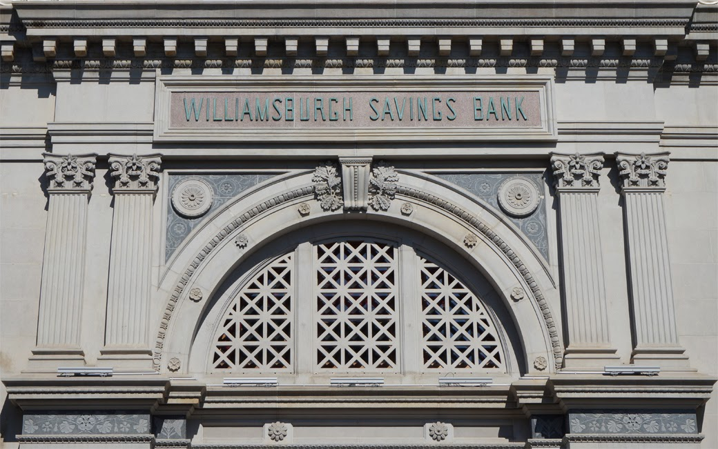 Arch and sign above main building entrance