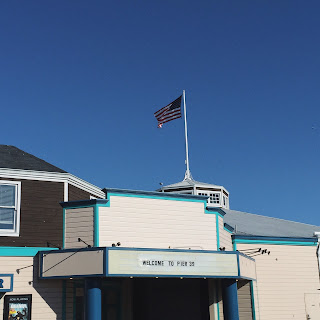 A picture of a flag at Pier 39, Fisherman's Wharf, San Francisco