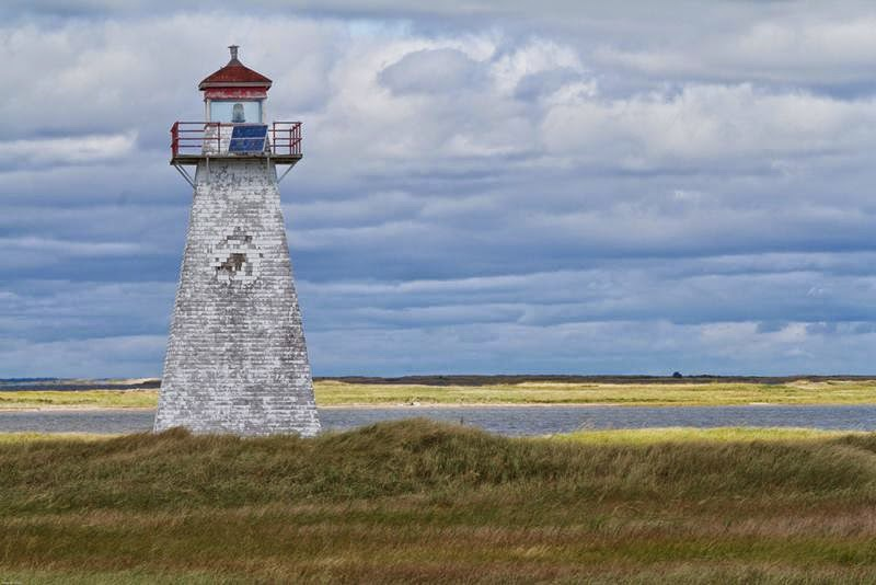 A lighthouse on the southern extremity of Buctouche sand bar was put in operation on October 10, 1902. The lighthouse is a square wooden building, surmounted by a square wooden lantern rising from the middle of the cottage roof.
