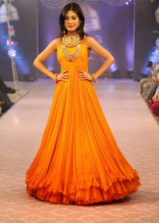 Amrita Rao's Ramp Walk in Orange Gown
