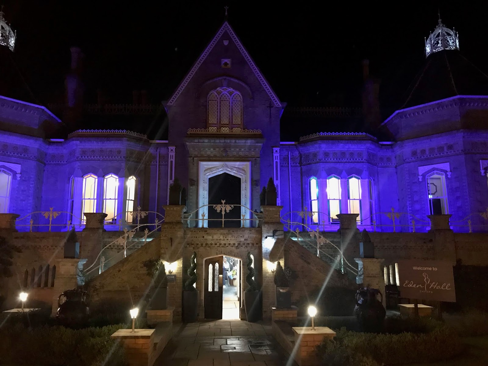 external view of Eden Hall spa at night