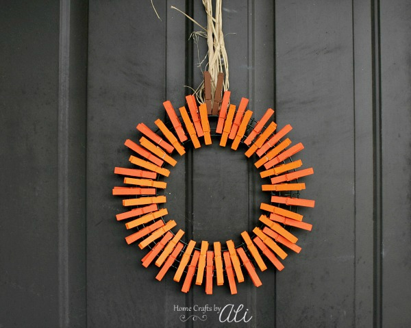 finished pumpkin clothespin wreath hanging on door