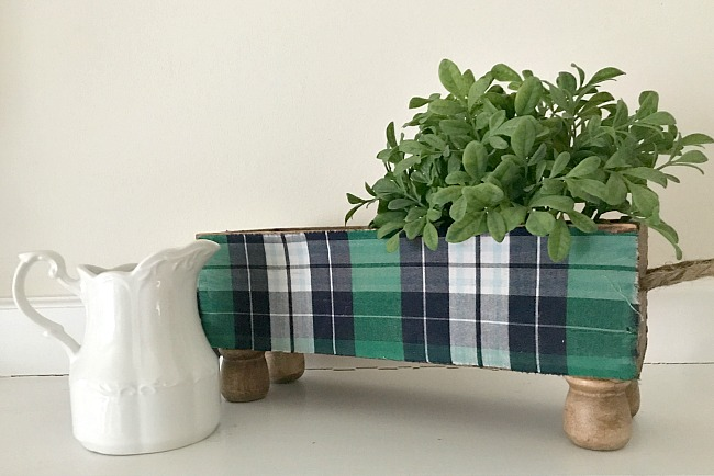 Plaid crate, creamer and greenery