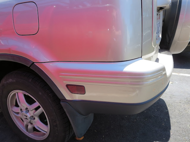 Dents on quarter panel and bumper repaired at Almost Everything Auto Body