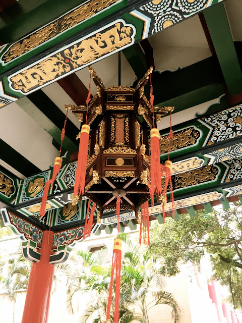 Traditional Chinese ornamentation - roof detailing & lantern at Sik Sik Yuen Wong Tai Sin Temple, Hong Kong