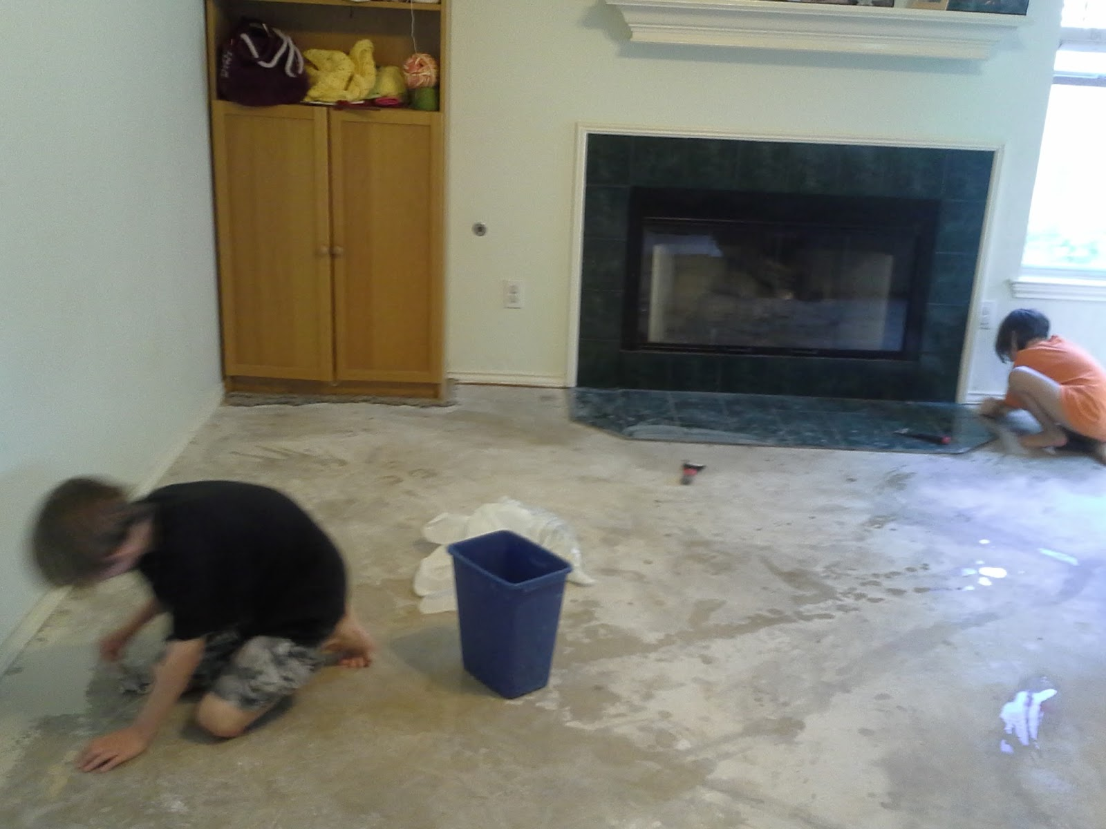 Asher Chiara Work To Clean The Paint Off Floor