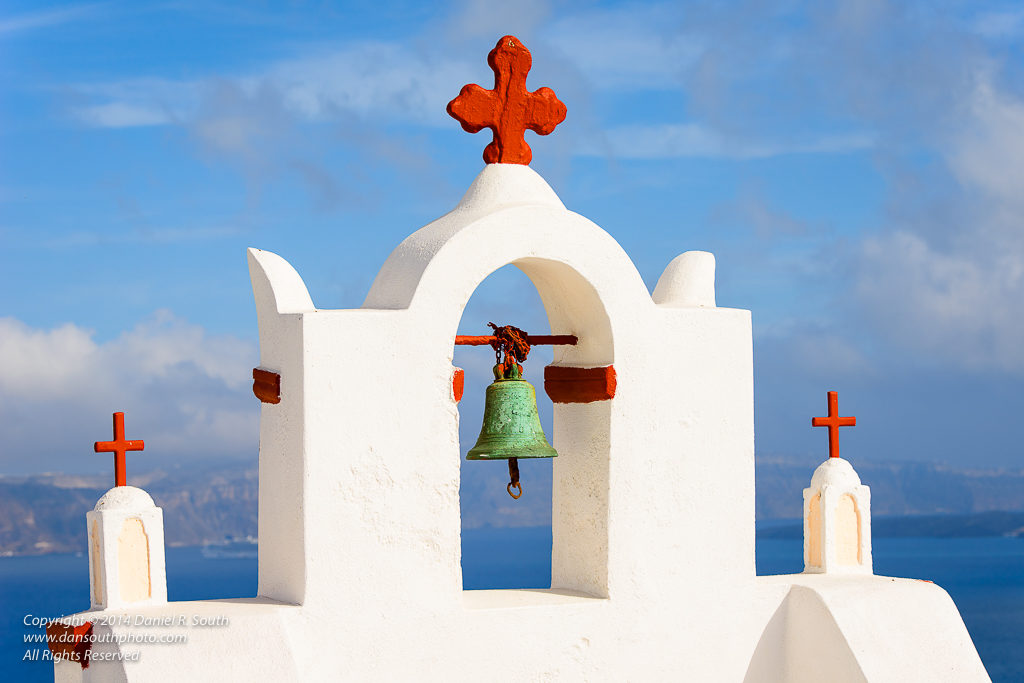 a photo of red crosses on a white chapel oia santorini