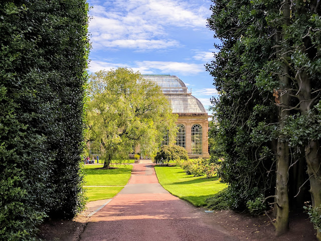Glasshouse viewed through the giant hedge at Royal Botanic Garden Edinburgh