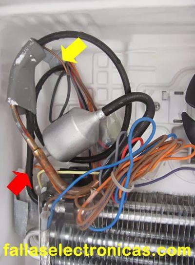 mi refrigerador enfria grano y refusal congela