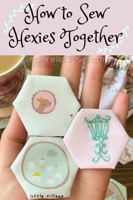How to sew hexies together - beginner quilting and English paper piecing tutorial! Learn how to make hexie flowers for a hexie mug rug in this beginner sewing series. Easy video tutorial and free pattern! #sewing #epp #englishpaperpiecing #quilting #sewingpattern #handsewing