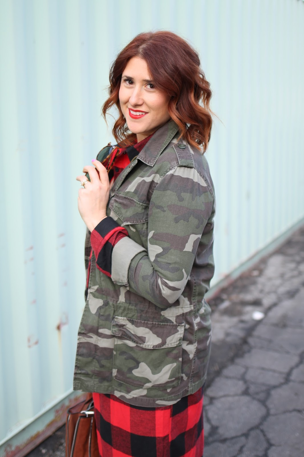 army camo surplus jacket, red lace slip, buffalo plaid check dress, curly red hair, red pumps