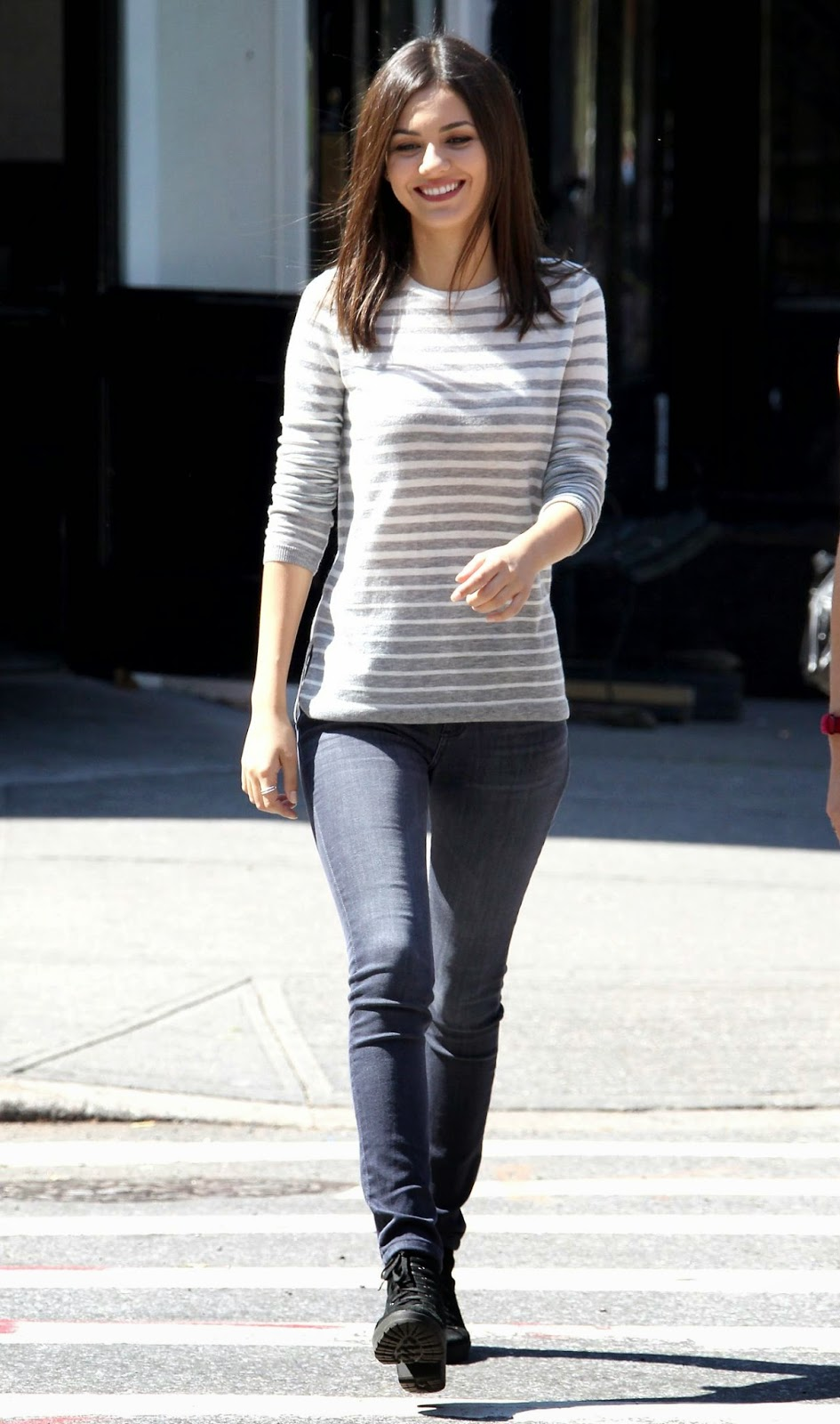 Victoria Justice in a striped top and skinny jeans on set in Brooklyn