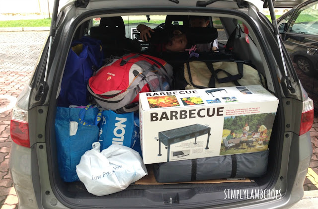 Car boot is fully filled with camping items.