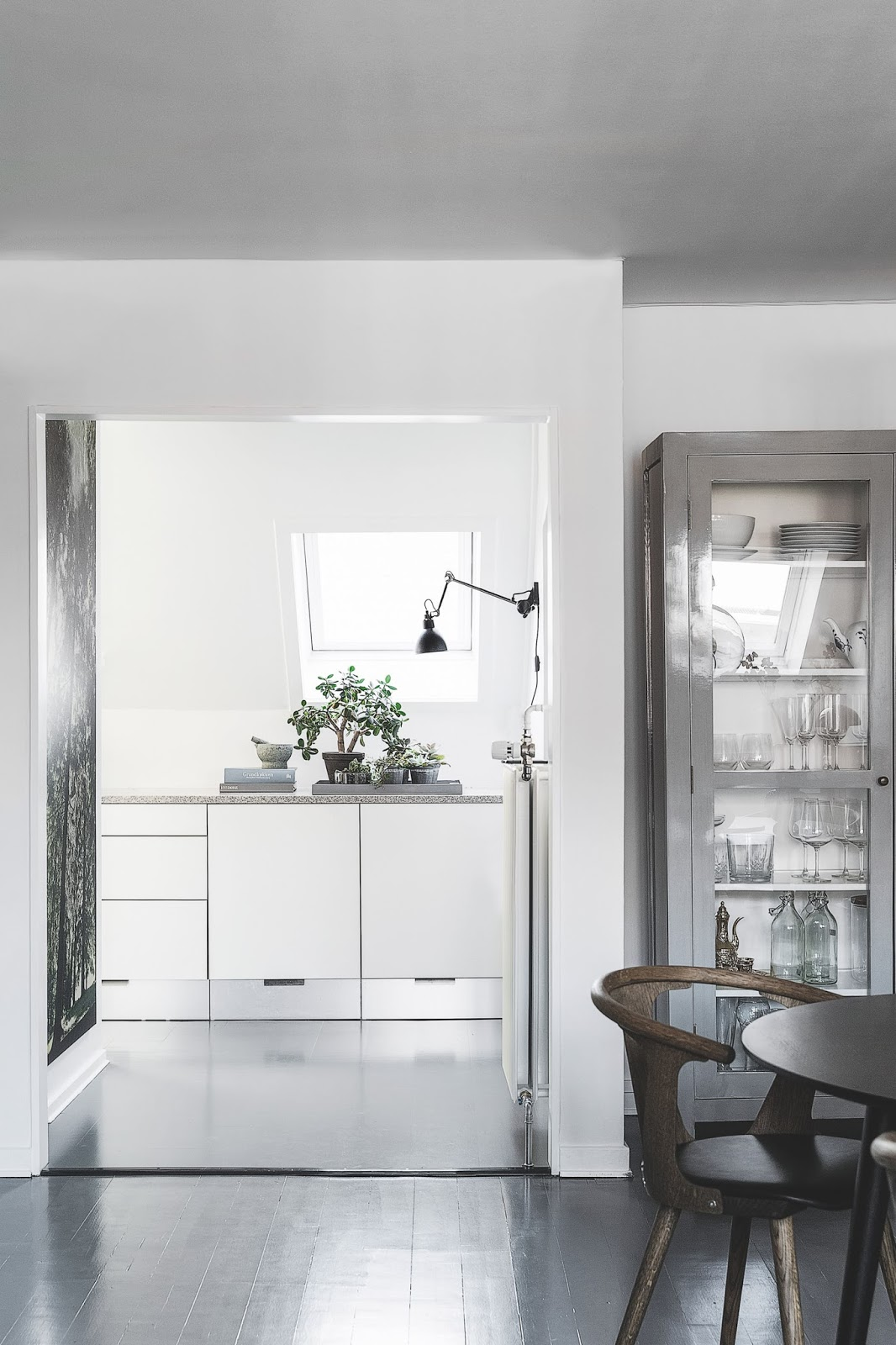 minimalist white kitchen with dark floors