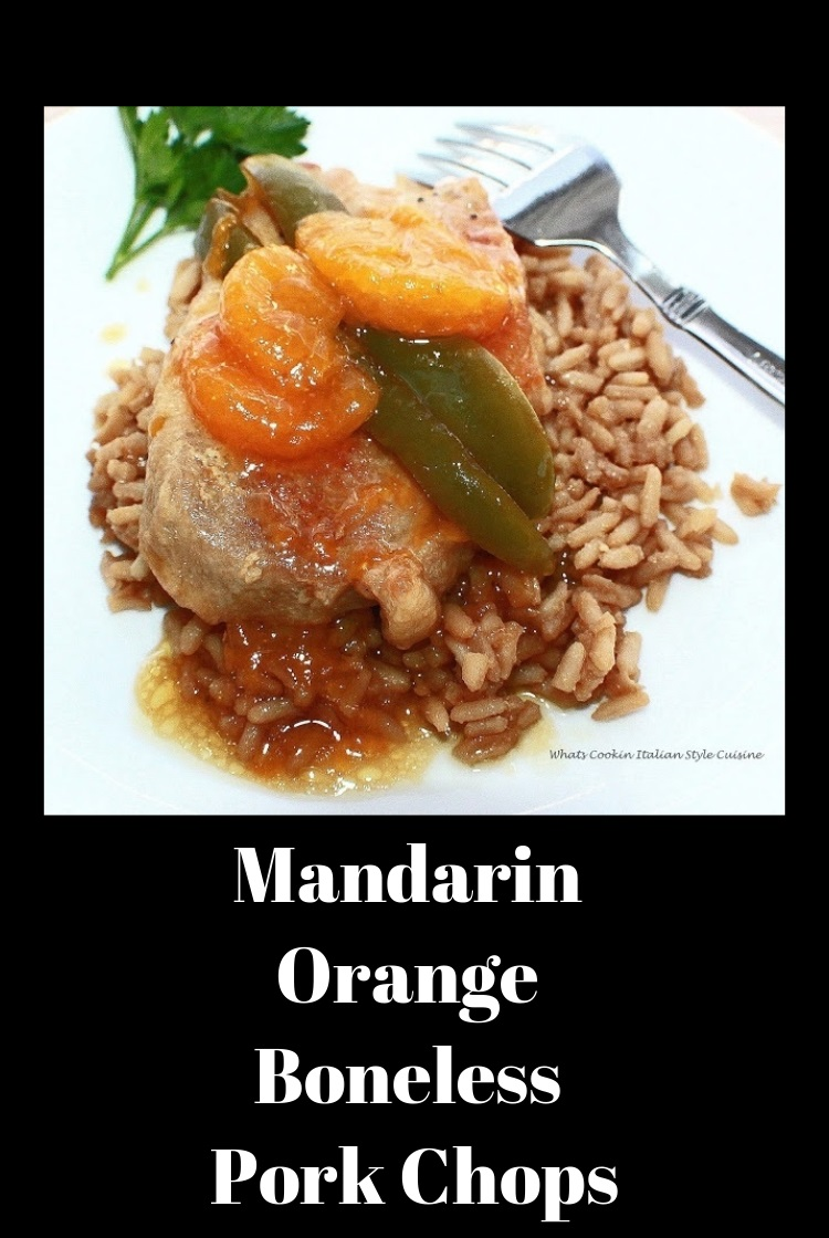 A thickened mandarin orange sauce with boneless pork over rice with peppers