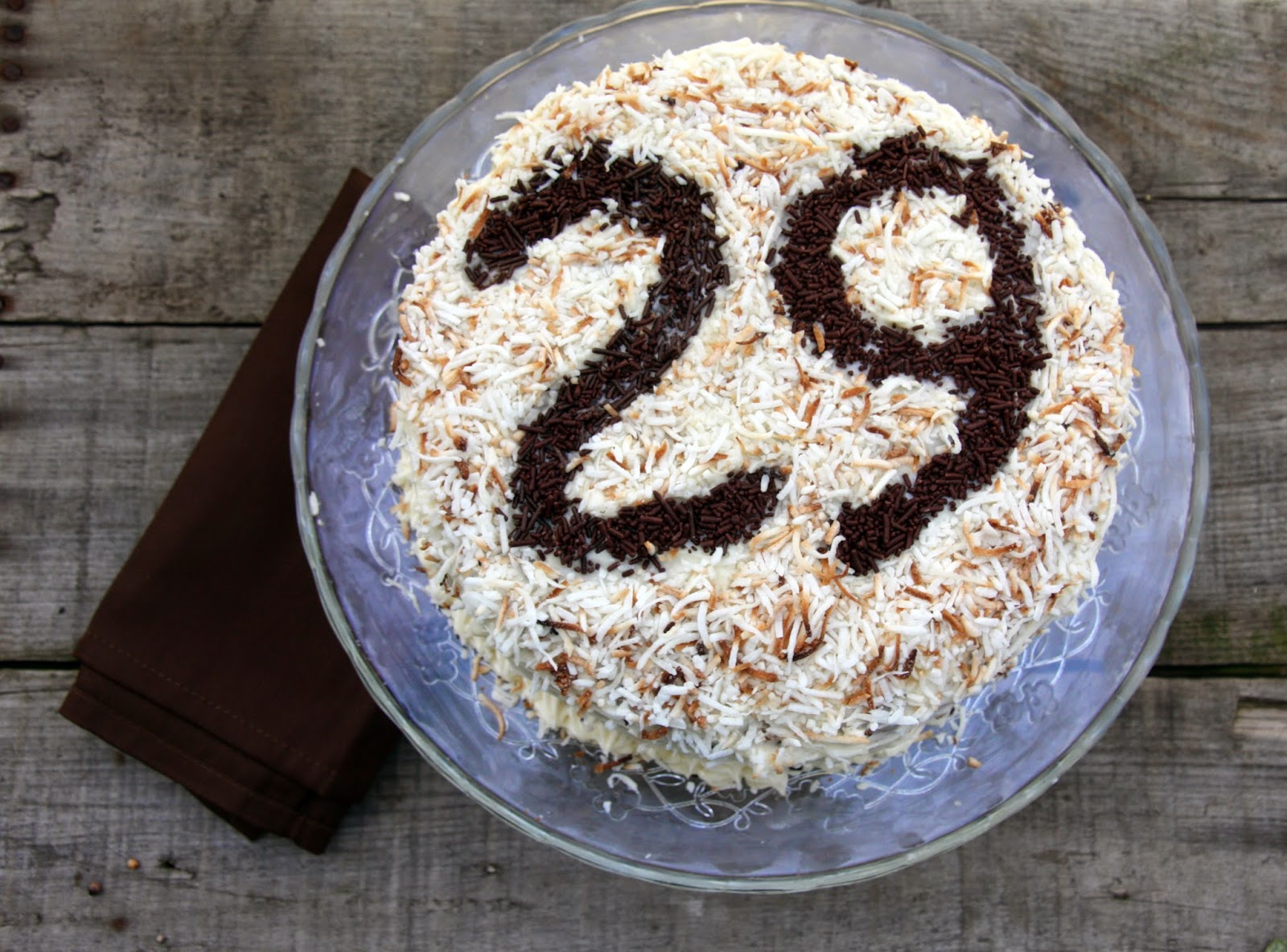 Carrot cake with toasted coconut and sprinkle numbers