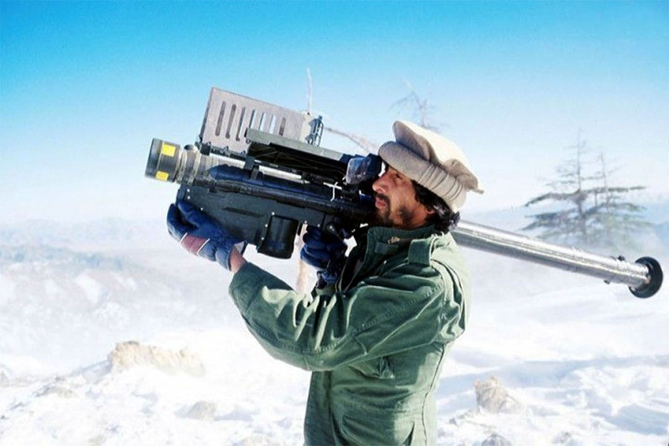 A guerrilla soldier aims a stinger missile at passing aircraft near a remote rebel base in the Safed Koh Mountains February 10, 1988 in Afghanistan.