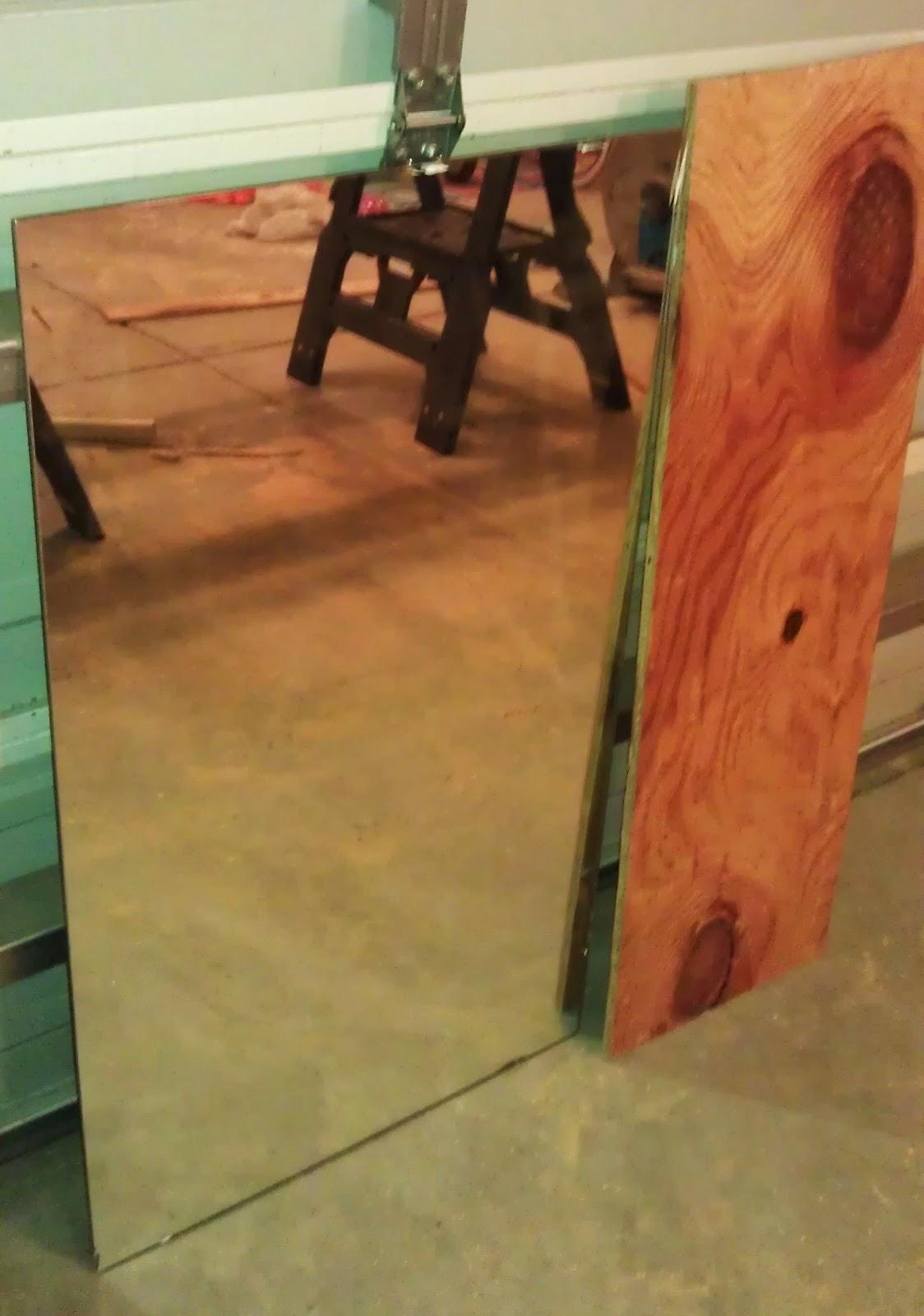 DIY: DIY bathroom mirror frame. Cost: $0.