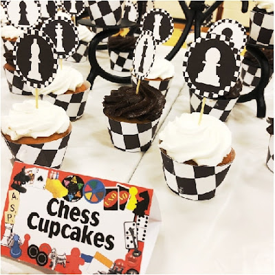 Turn regular cupcakes into a game of chess with these printable cupcake wrappers and cupcake toppers perfect for your next game night party dessert table.