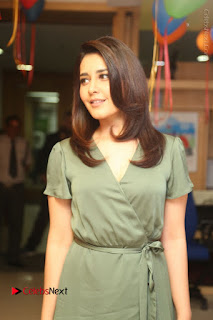 Actress Raashi Khanna Stills in Green Short Dress at Mirchi 95 Suno Aur Mercedes Jeeto Contest 0067