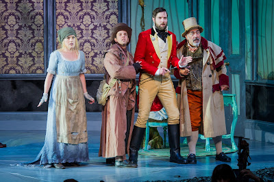 Victoria Simmons as Angelina, Nico Darmanin as Prince Ramiro, Nicholas Lester as Dandini, Jonathan Veira in La Cenerentola at Opera Holland Park. Photographer Robert Workman