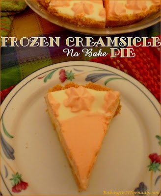 Frozen Creamsicle No Bake Pie takes you back to those warm summer days of your childhood. | Recipe developed by www.BakingInATornado.com | #recipe #dessert