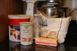 frosting ingredients - shortening, meringue powder, butter, vanilla, powdered sugar